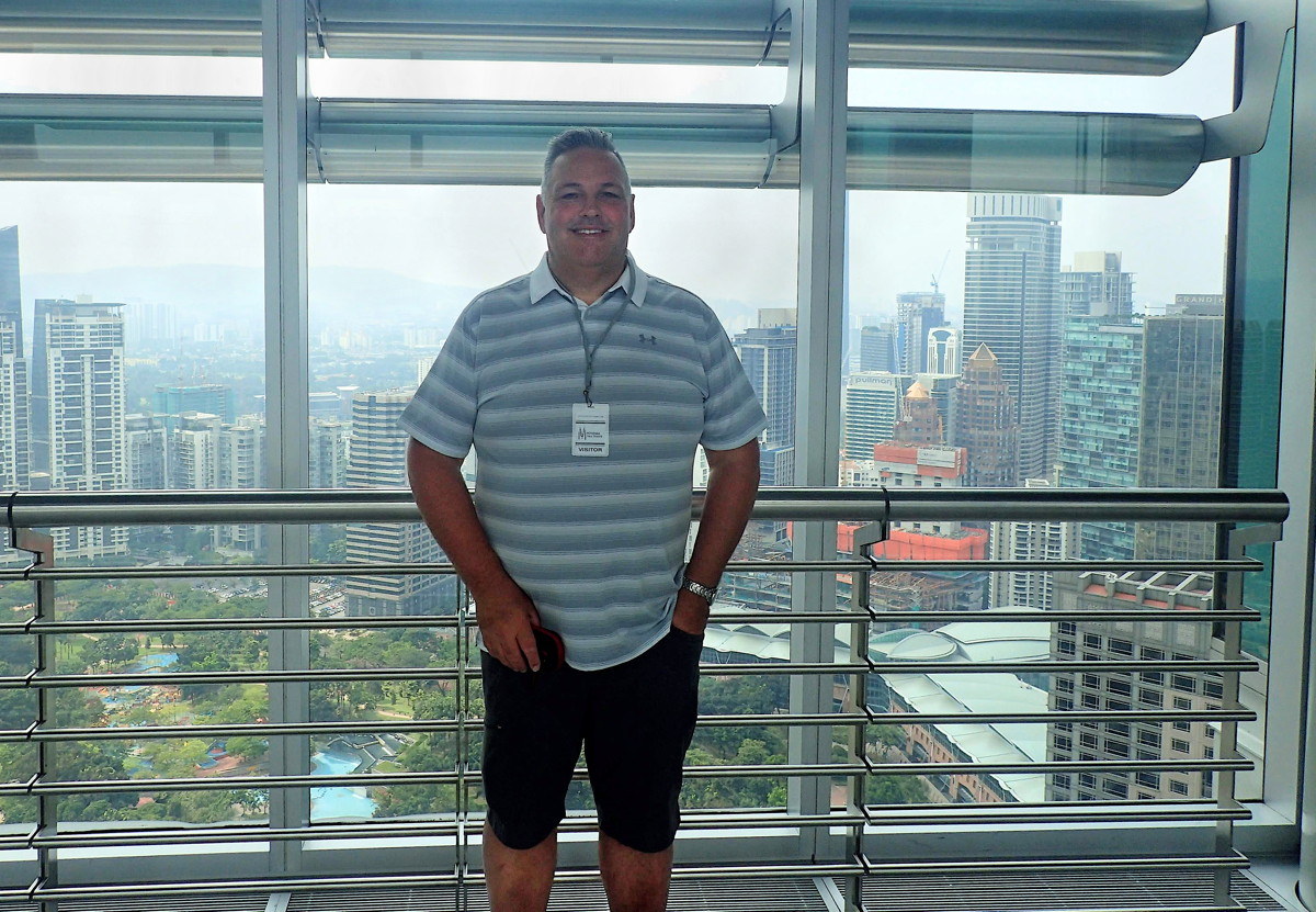 Andrew Dawson at the Petronas Towers in Kuala Lumpur, Malaysia. Photo courtesy of Andrew Dawson.
