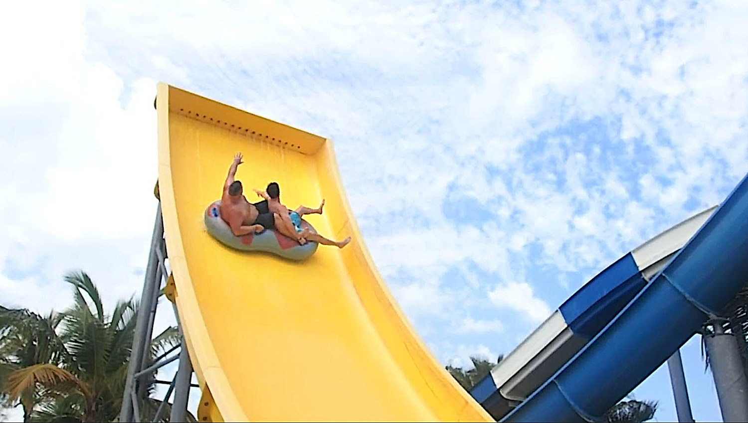 HOLD ON TIGHT. Dawson (left) hits the slide at Grand Memories Splash in Punta Cana. The Sunwing COO says he always packs a swimsuit when he travels. Photo courtesy of Andrew Dawson.