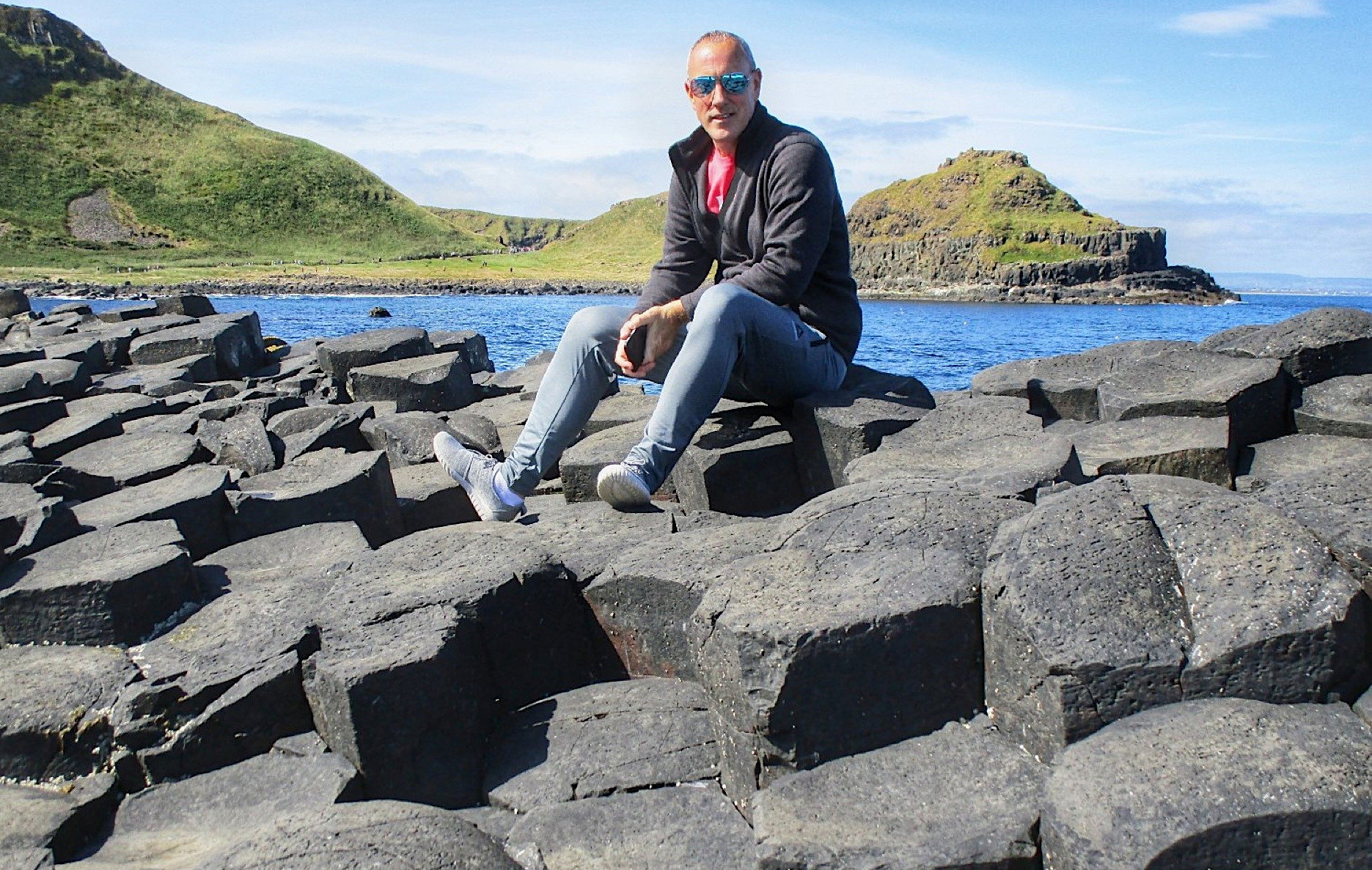 Marsh, seen here at Giant's Causeway in Northern Ireland, was inspired to pursue a career in travel after meeting a group of travel agents while backpacking through Europe in the early '90s. Photo courtesy of Freddie Marsh.