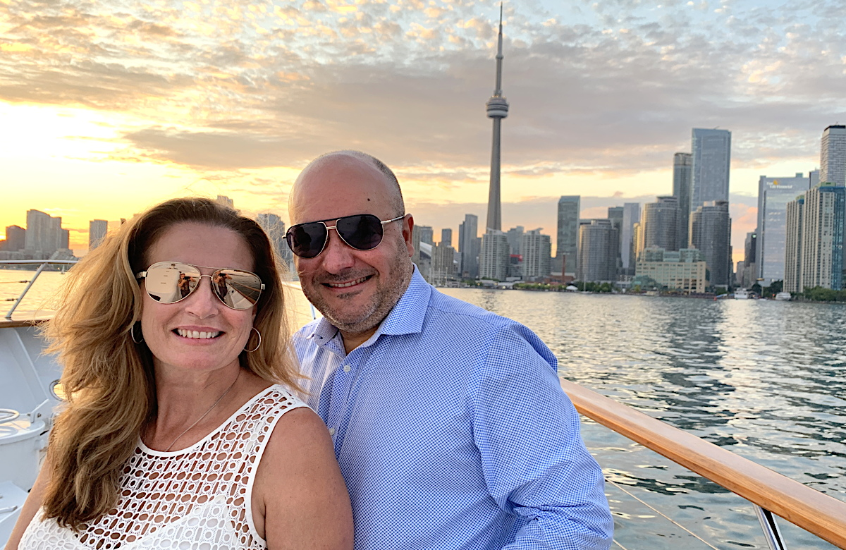 Travel experts Barbara Scrocco (left) and Robert Rizzo of TravelOnly enjoy the sunset from Lady Sandals.