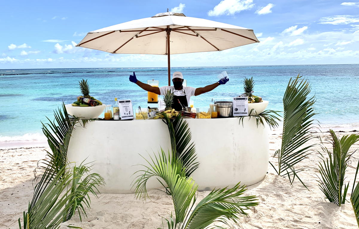 A bartender serves up cocktails on the beach at Club Med Punta Cana.