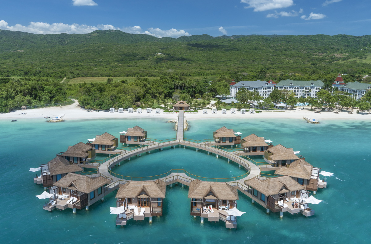 ULTIMATE GETAWAY. Sandals South Coasts' signature over-the-water bungalows form a heart shape. Photo courtesy of Sandals Resorts.