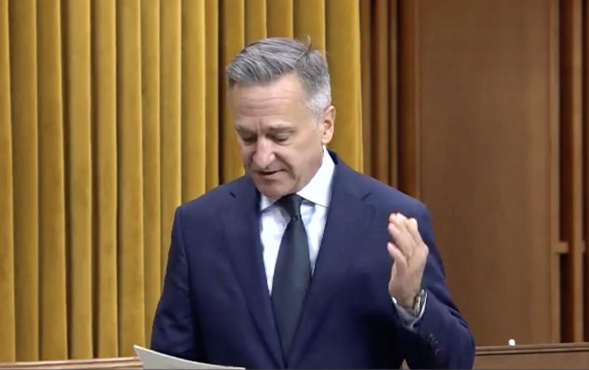 MP James Cumming of Edmonton Centre in Alberta, defends travel agents in the House of Commons.