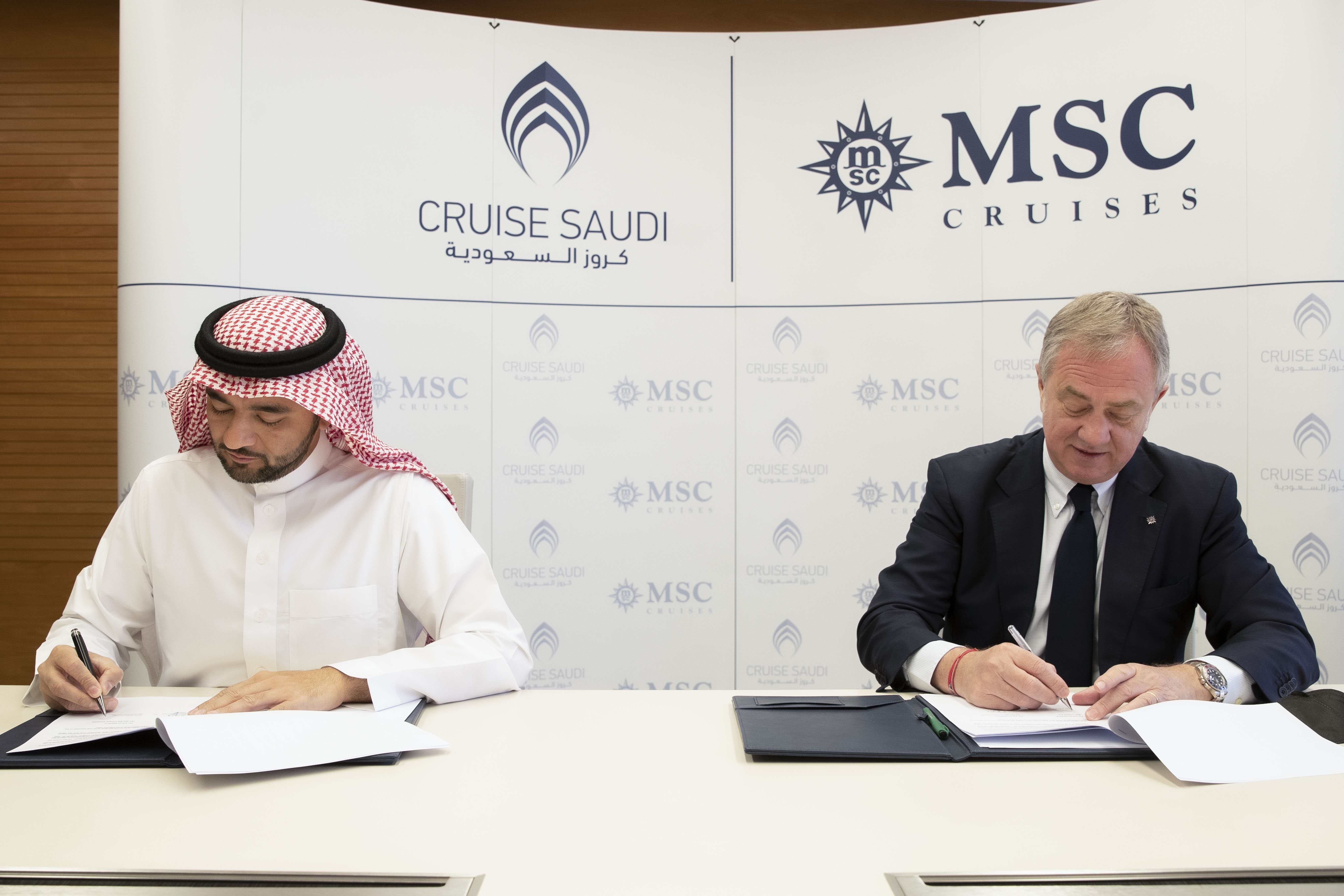 Fawaz Farooqui, Managing Director of Cruise Saudi (left) & Pierfrancesco Vago, Executive Chairman of MSC Cruises, sign the agreement in Riyadh. (MSC)