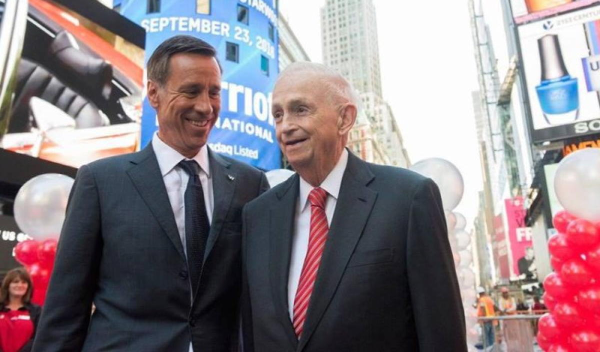 Arne Sorenson (left) with J.W. Marriott in Times Square. (Marriott)