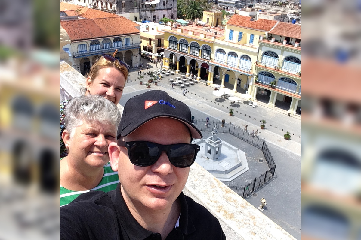 Eloy and his family taking in the views of the Old Havana Square. (Supplied photo)
