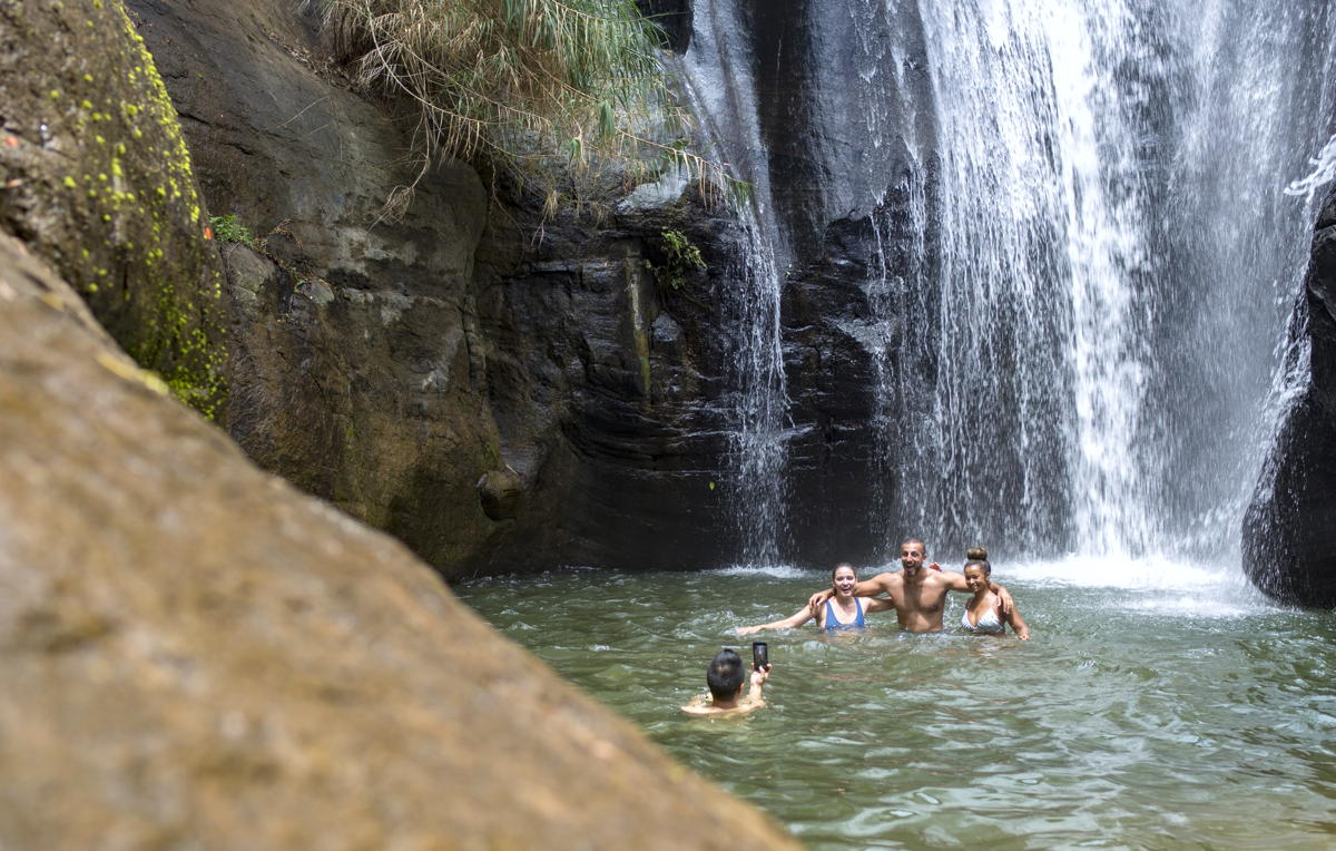 A group swimming beneath Sri Lanka Ella waterfall. (Supplied)