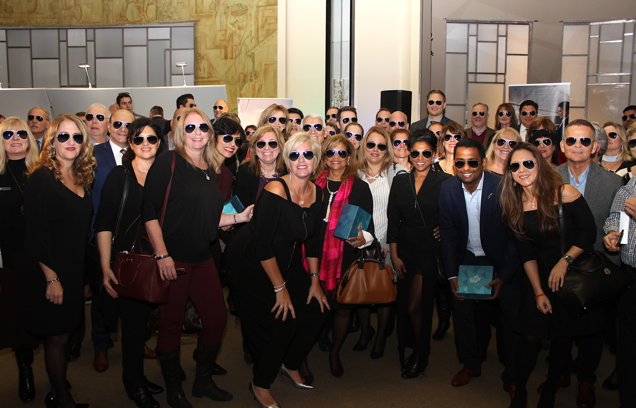 GOOD LOOKING GROUP. Attendees received signature WestJet aviator sunglasses last night.