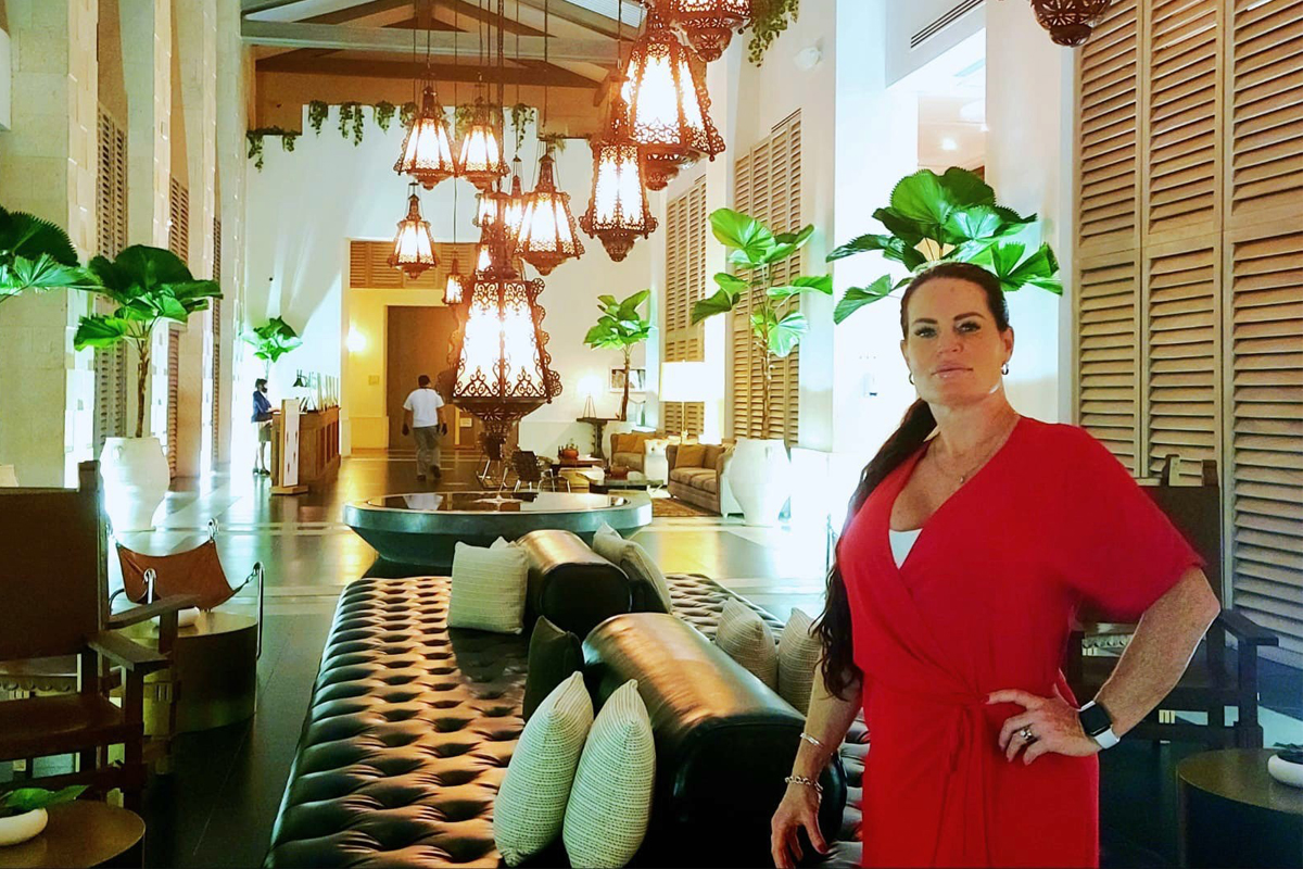 Tracie-Marie Landry, a destination wedding specialist and travel designer with OHANA Travels, poses in the lobby of Unico 2087.