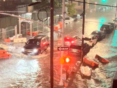 """NYC issues travel ban as """"historic"""" rain floods subways, streets"""