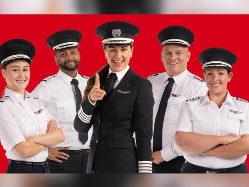 """VIDEO: """"There's nowhere we haven't been"""": Flight Centre unveils 1st female captain"""